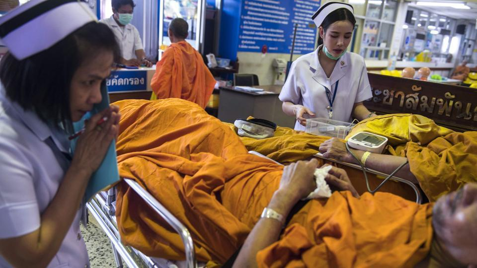 """The monks also should do something, like exercise... like walking meditation, cleaning the temple in the morning, sweeping the grounds,"" he said. The guidelines follow smaller-scale initiatives in rural Thailand. Since monks tend to move from one temple to the next, many don't visit doctors or dentists for check-ups, he said. (Romeo Gacad / AFP)"