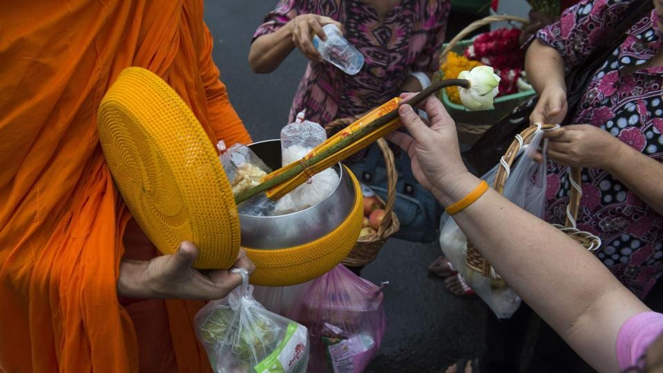 Thais seeking to earn merit and honour their ancestors often provide food to monks on their daily rounds but they can be generous to a fault. Heavy curries, sugary sweets, sodas and salty snacks are among the array of sumptuous -- and unhealthy -- alms. (Romeo Gacad / AFP)