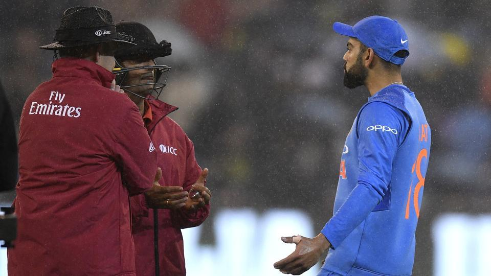 India's Virhat Kohli gestures as he talk with the umpires as rain falls during the Twenty20 international. (AP)