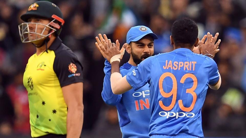 Jasprit Bumrah (R) is congratulated by captain Virat Kohli (C) after dismissing Australia's batsman Marcus Stoinis during their T20 international cricket match at the MCG in Melbourne. Rain played spoilsport as the match was abandoned. Not a single ball was bowled after Australia posted 132/7 in 19 overs. (William West / AFP)