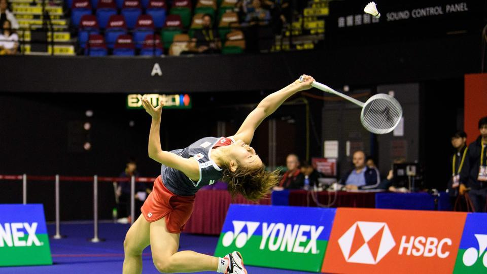 Japan's Nozomi Okuhara hits a return against Thailand's Ratchanok Intanon during their women's singles final at the Hong Kong Open badminton tournament. (Anthony Wallace / AFP)
