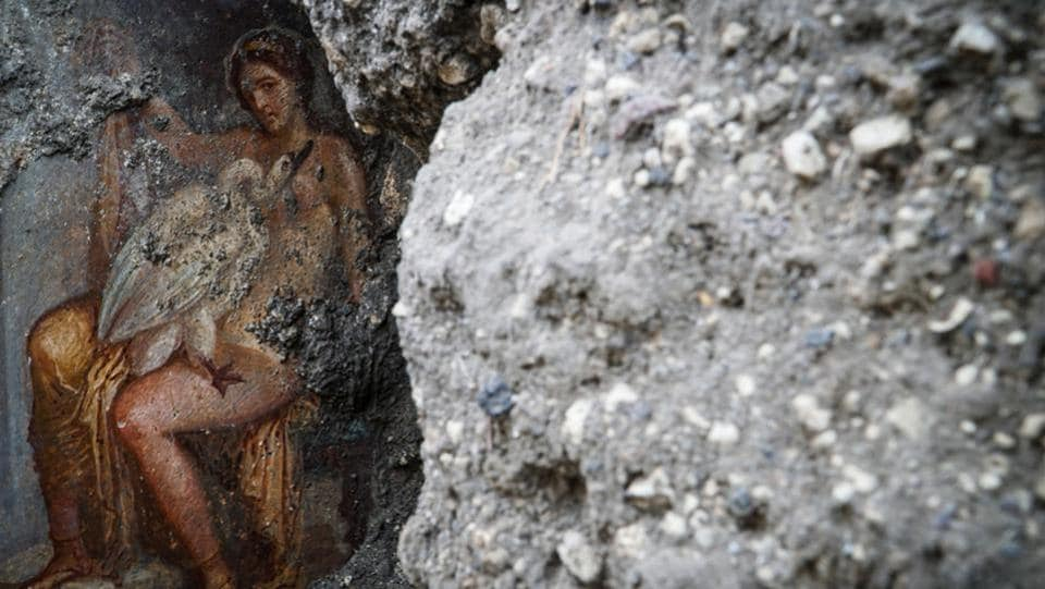 A handout by the Press Office of the Pompeii Archaeological Park shows a newly-discovered fresco, representing Greek mythological princess Leda and a swan, in an ancient Pompeii bedroom. (Cesare Abbate / AFP)