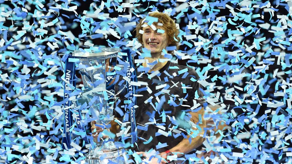 Germany's Alexander Zverev is covered in ticker tape after being presented with the trophy, having beat Serbia's Novak Djokovic in their men;s singles final match on day eight of the ATP World Tour Finals tennis tournament at the O2 Arena in London, England. (Glyn Kirk / AFP)