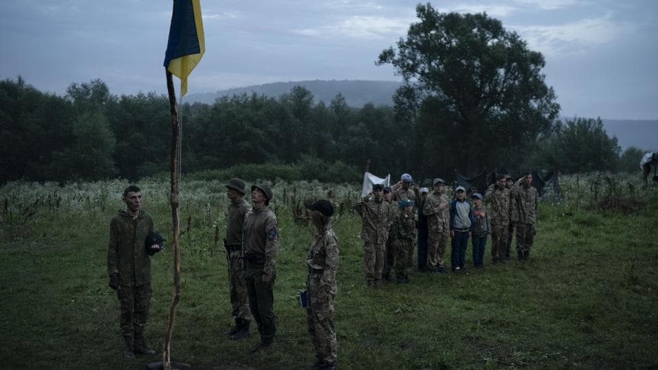 "The nationalists have been accused of violence and racism, but they have played a central, volunteer role in Ukraine's conflict with Russia — maintaining links with the government. Earlier this year, the Ministry of Youth and Sports earmarked 4 million hryvnias (about $150,000) to fund some of the youth camps among the dozens built by the nationalists. The purpose, according to the ministry, is ""national patriotic education."" (Felipe Dana / AP)"
