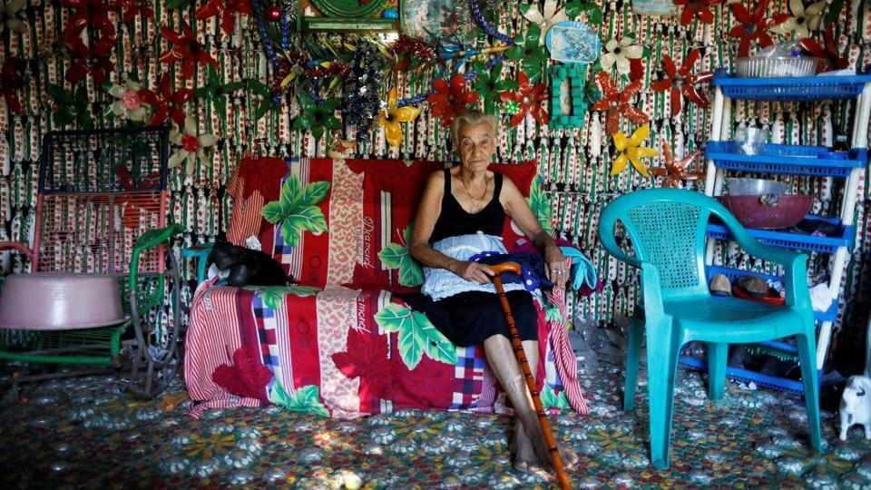 Maria Bersabe Ponce, 87, sits inside her house made out of plastic bottles in the village of El Borbollon in El Transito, El Salvador. (Jose Cabezas / REUTERS)
