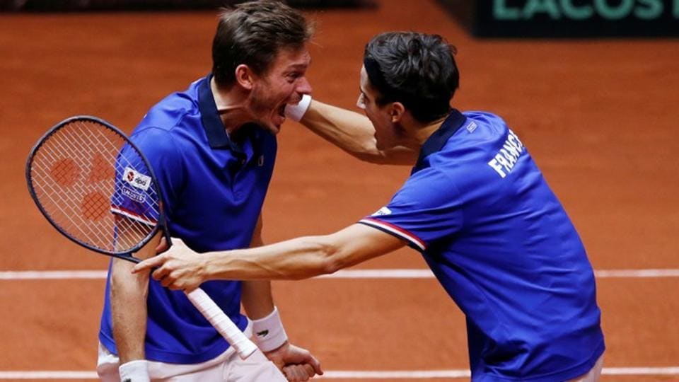 France's Pierre-Hugues Herbert and Nicolas Mahut celebrate winning their doubles match against Croatia.