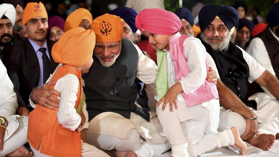 PM Narendra Modi interacts with children at a programme to celebrate Guru Nanak Dev Ji's birth anniversary, at the residence of Union minister Harsimrat Kaur in New Delhi on Friday, November 23, 2018.