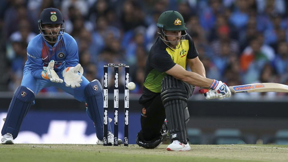 Australia's Aaron Finch plays a sweep shot as India's Rishabh Pant watches during their Twenty20 cricket match in Sydney, Sunday, Nov. 25, 2018. (AP Photo/Rick Rycroft) (AP)
