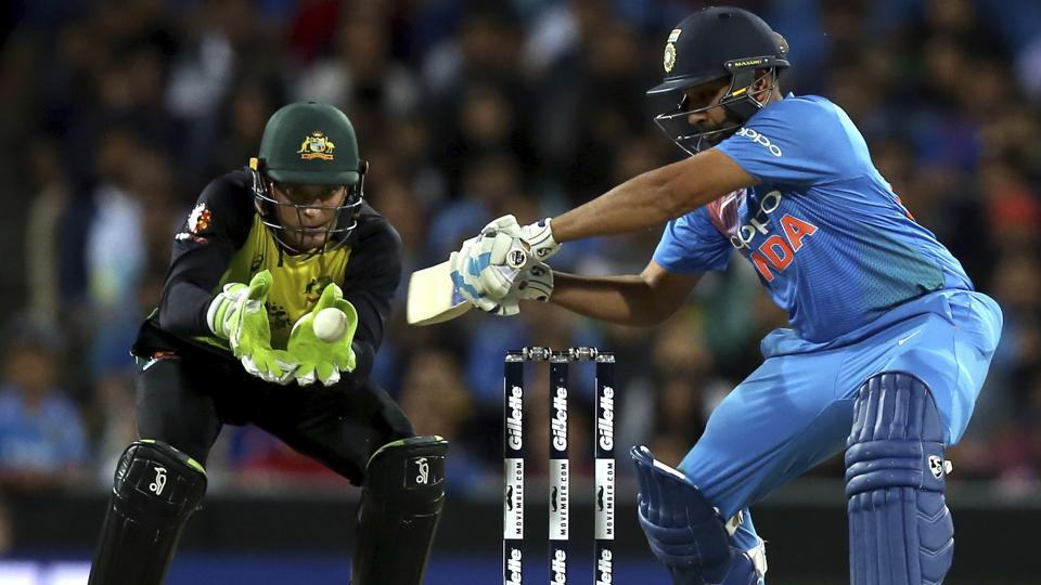 India's Rohit Sharma reaches for the ball while batting against Australia during their Twenty20 cricket match in Sydney. (AP)