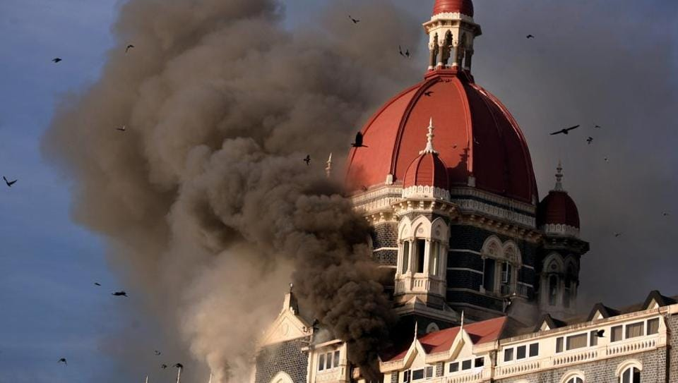 In this file photo, a cloud of smoke can be seen belching out from below the main dome of Taj Hotel on Thursday Morning November 27, 2008.