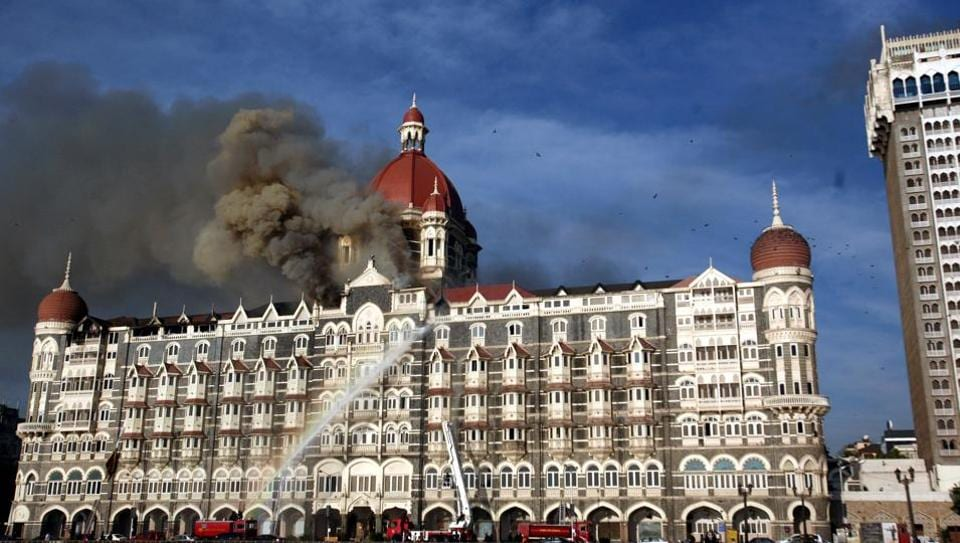 In the file photo, fire brigade officers are seen fighting fire at Taj hotel.