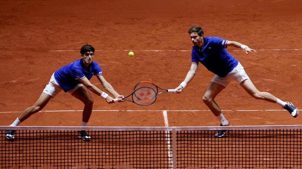 France's Pierre-Hugues Herbert and Nicolas Mahut in action during their doubles match against Croatia's Ivan Dodig and Mate Pavic.