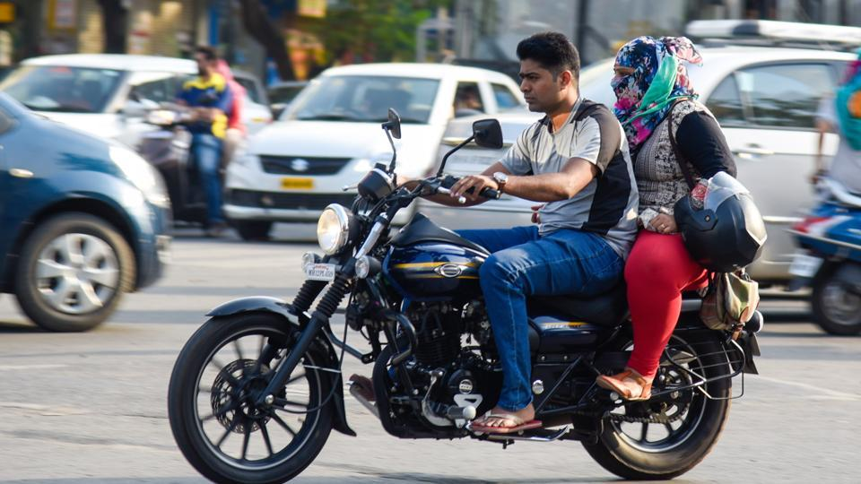While the man is driving a motorbike without a helmet the women is carrying it like a bag. With increasing population and increase in number of vehicles that run on the roads on a day-to-day basis, Pune traffic incharge bodies have made wearing helmet compulsory from January 1.