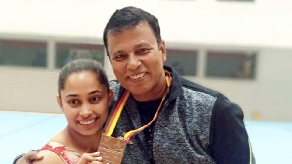 Cottbus : Indian gymnast Dipa Karmakar poses with her coach Bisweswar Nandi after wining bronze in Vault event at Artistic Gymnastic World Cup in Cottbus, Germany, Saturday, Nov 20, 2018