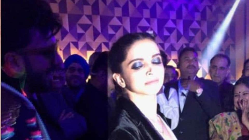Deepika Padukone later changed into a white vest and a black suede jacket.