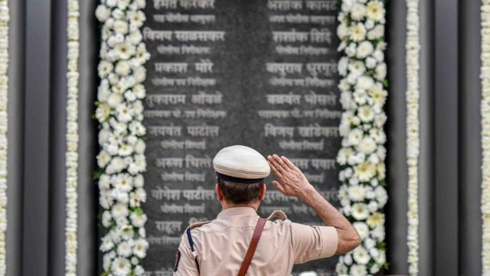 A Mumbai Police personnel pays tribute to martyrs of the 26/11 terror attacks on its tenth anniversary at the Martyrs' Memorial, Police Gymkhana in Mumbai. On November 26, 2008, 10 Pakistani terrorists arrived by sea route and opened fire indiscriminately, killing 166, including 18 security personnel, and injuring several others, besides damaging property worth crores. (Kunal Patil / HT Photo)