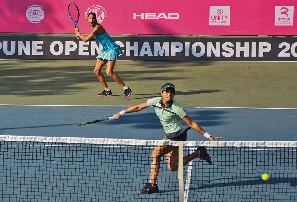 Ankita Raina (blue cap) and Karman Kaur Thandi in action during the Pune Open women's championship at the Shiv Chhatrapati sports complex in Balewadi on Monday. Raina-Thandi defeated Kaylah Mcphee of Australia and Pei-Chi Lee of Taipei 6 -2, 6-4, in the doubles round one match.