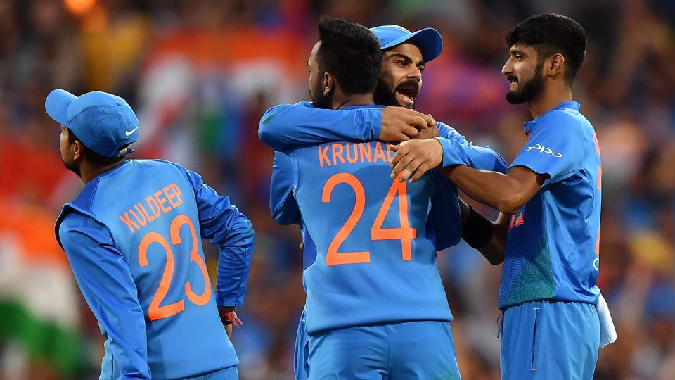 India's captain Virat Kohli (C) celebrates the dismissal of Australia's Alex Carey off India's spin bowler Krunal Pandya (#24) during a T20 international cricket match at the SCG in Sydney on November 25, 2018.