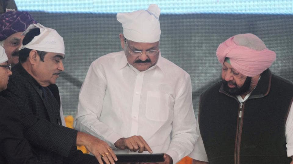 Vice President M Venkaiah Naidu (C), Punjab chief minister Amarinder Singh (R) and Union minister of Road Transport and Highway Nitin Gadkari (2L) officiate the foundation stone-laying ceremony for the planned Dera Baba Nanak-Kartarpur Sahib road corridor to the Pakistan border, at Dera Baba Nanak, on the outskirts of Amritsar on November 26.