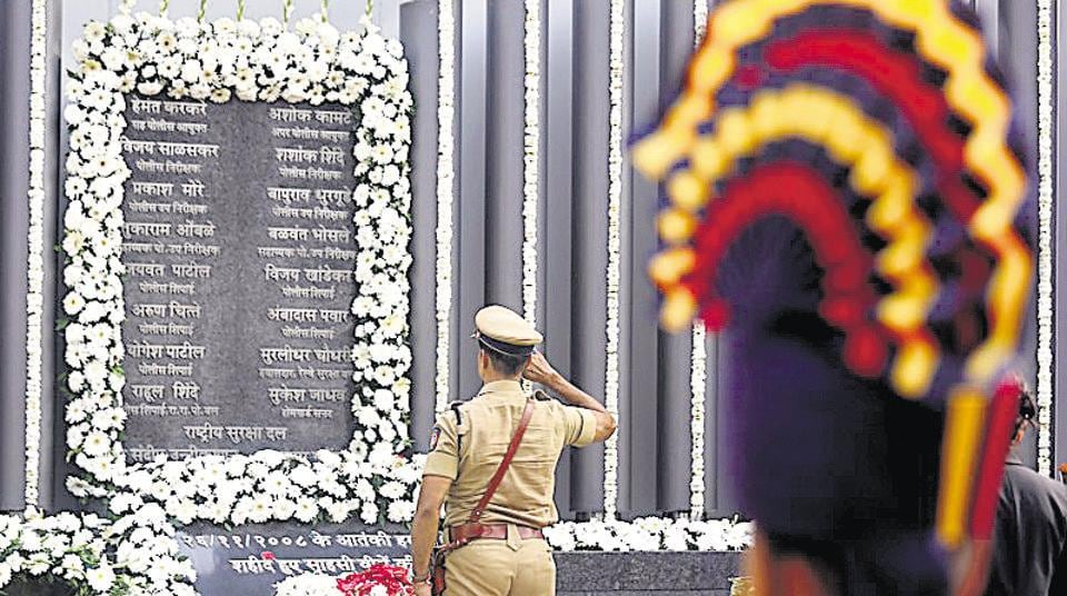 A policeman pays his respects at a 26/11 memorial on the 10th anniversary of the attacks, in Mumbai on Monday.