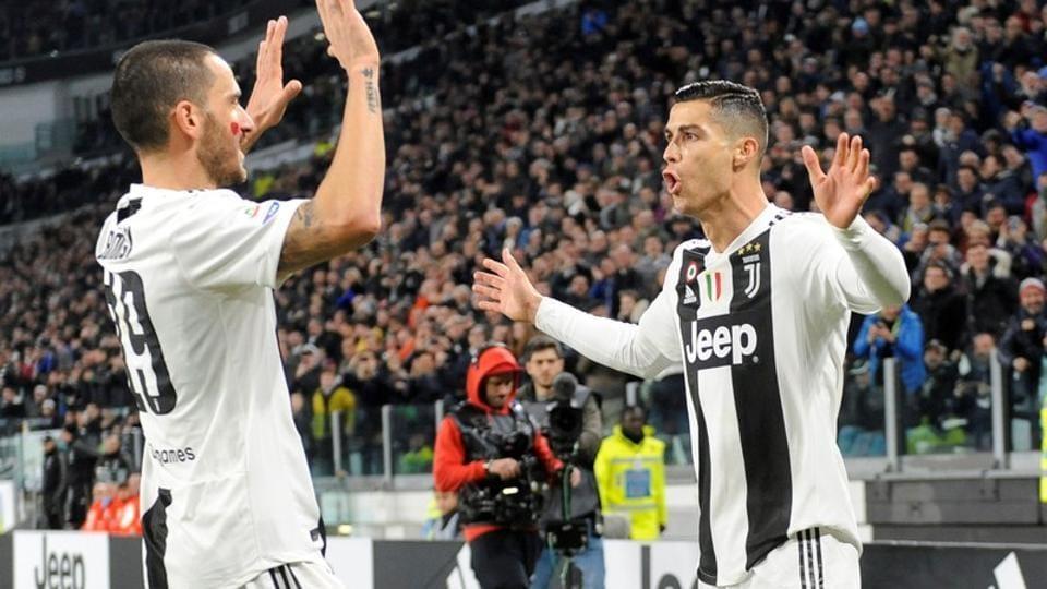 Juventus' Cristiano Ronaldo celebrates scoring their first goal with Leonardo Bonucci