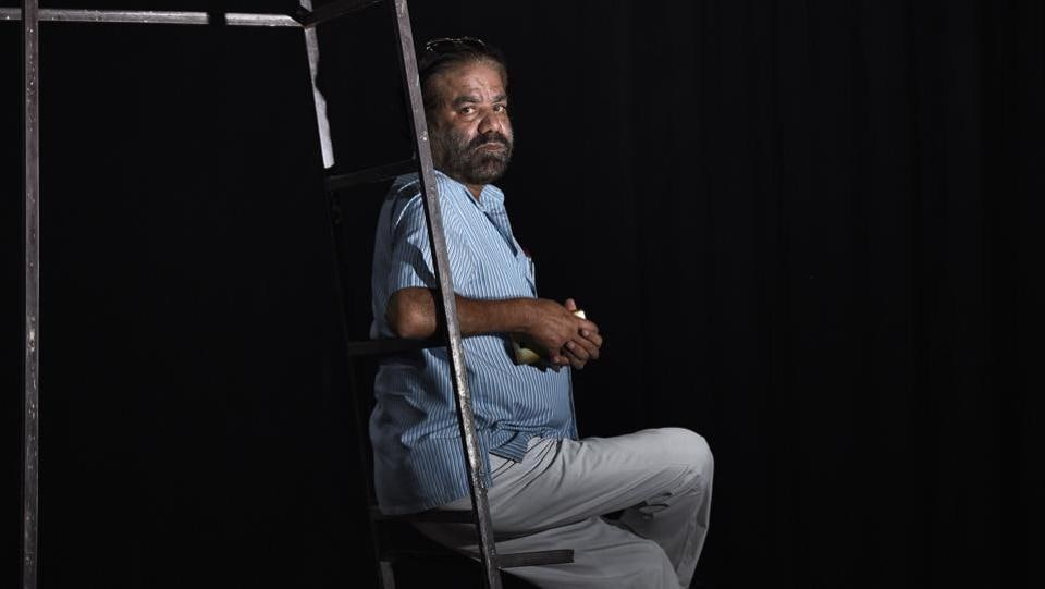 "After his team performed Othello, 59-year-old Zareef Malik Anand (pictured) was working hard, appealing before a local politician for better lighting facilities at Shahjahanpur's Gandhi Bhavan auditorium. ""What you see now is a sea change from the time when I started out,"" he said, recalling open arenas in schools and temples with rented equipment. ""We have come very far. But this is nowhere near decent,"" he said.  (Burhaan Kinu / HT Photo)"