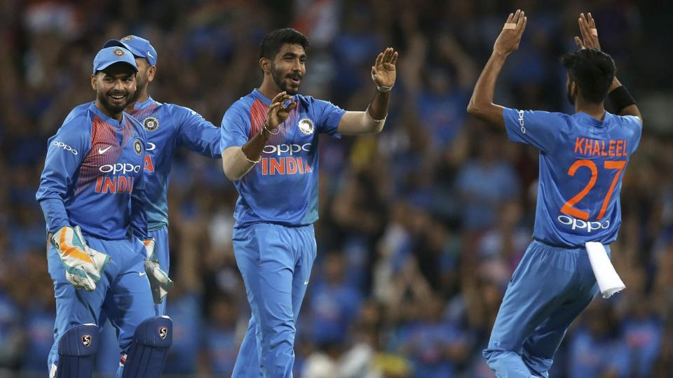India's Jasprit Bumrah, centre, is congratulated by teammates after running out Australia's Chris Lynn during their Twenty20 cricket match in Sydney.