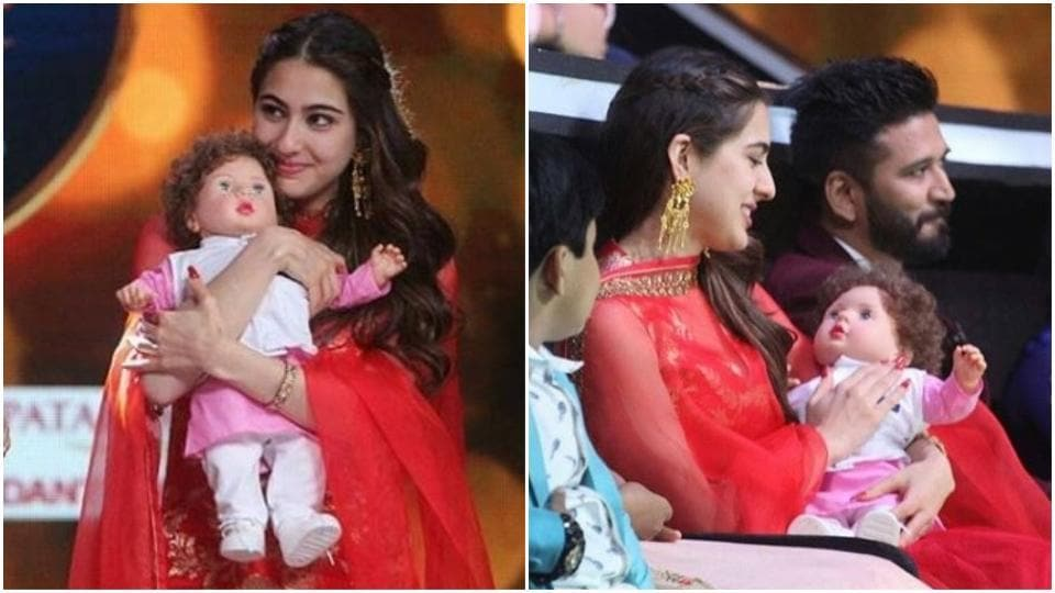 Sara Ali Khan was spotted cradling a Taimur doll on Sa Re Ga Ma Pa.