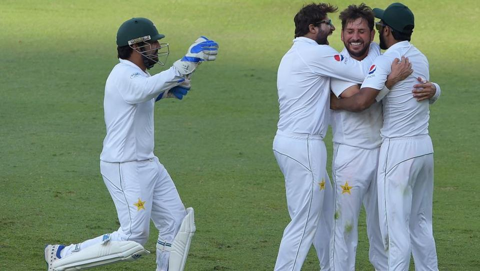 Pakistani cricketer Yasir Shah (2nd R) celebrates with teammate Hasan Ali (R), Imam-ul-Haq and captain Sarfraz Ahmed (L) after taking the final wicket of New Zealand batsman Trent Boult