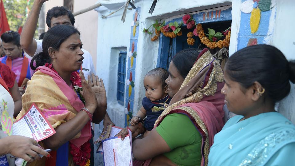 A 32-year-old Indian transgender, Chandramukhi Muvvala talks to voters while she campaigns at Goshamahal constituency in Hyderabad on November 26.