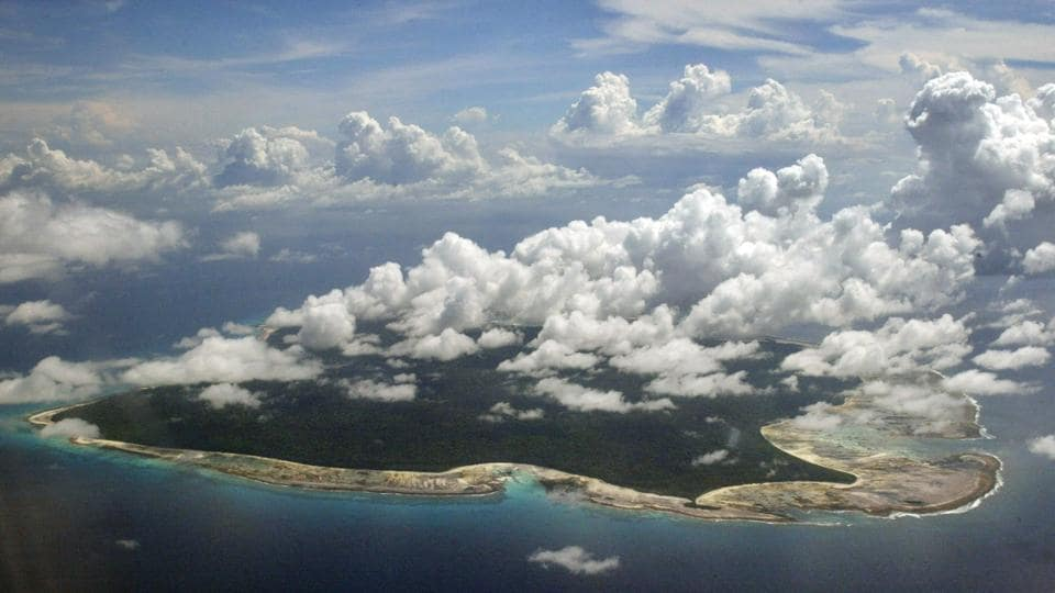 In this Nov. 14, 2005 photo, clouds hang over the North Sentinel Island, in Andaman and Nicobar Islands.