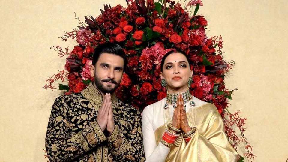 Ranveer Singh and Deepika Padukone greet the guests at their Bengaluru reception.