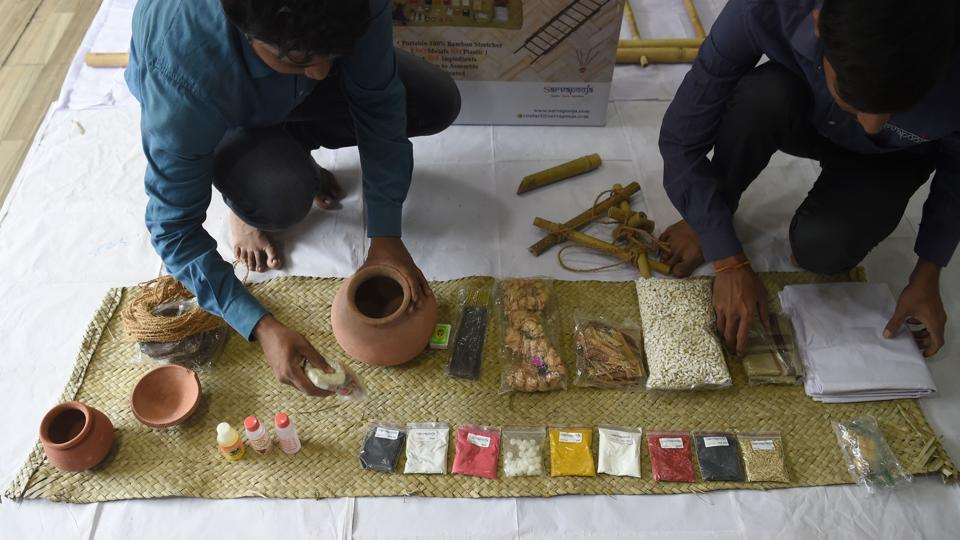 """Workers arrange the various materials of """"a final rites kit"""" at the company SarvaPooja's manufacturing unit in Mumbai. Grieving families normally have to rush between shops buying dozens of items needed to say goodbye to loved ones but now online companies are offering a one-stop solution with """"final rites kits"""". (Indranil Mukherjee / AFP)"""