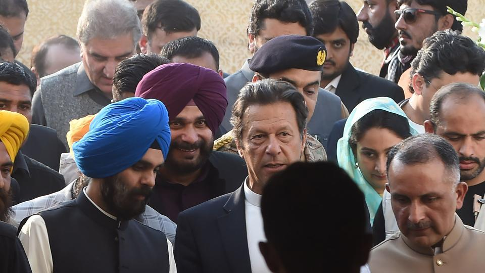 Pakistan Prime Minister Imran Khan (C) and alongside Indian Minister for Food Processing Industries Harsimrat Kaur Badal (2R) and India's Punjab cabinet minister and former cricketer Navjot Singh Sidhu (3L), arrive to attend the groundbreaking ceremony for the Kartarpur Corridor in Kartarpur on November 28, 2018.