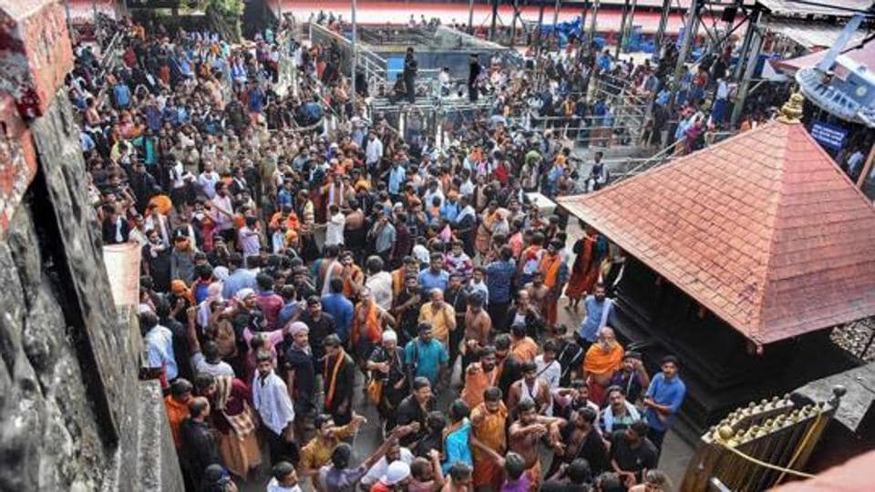 Hindu devotees stage a protest at Sabarimala temple after a woman who reached near the 18 holy steps of the hilltop shrine was heckled by agitators over her age, at Sabarimala, in Pathanamthitta district