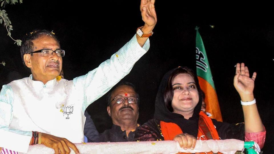 Madhya Pradesh chief minister Shivraj Singh Chouhan at a roadshow in support of BJP candidate from Bhopal North assembly constitutency Fatima Rasool Siddiqui (R) for State Assembly election, in Bhopal on November 22, 2018.