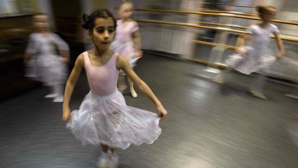 In a small studio in northern Moscow, girls as young as three in tutus and pointe shoes practise their ballet moves in front of a mirror. Lined up on their mats, the youngsters have no difficulty stretching their legs up over their heads -- let alone doing splits. (Mladen Antonov / AFP)