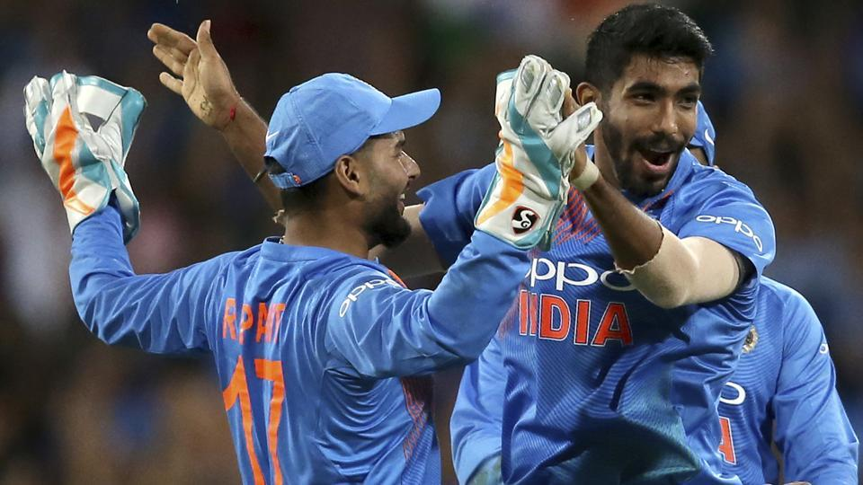 Jasprit Bumrah, right, is congratulated by teammate India's Rishabh Pant after running out Australia's Chris Lynn.