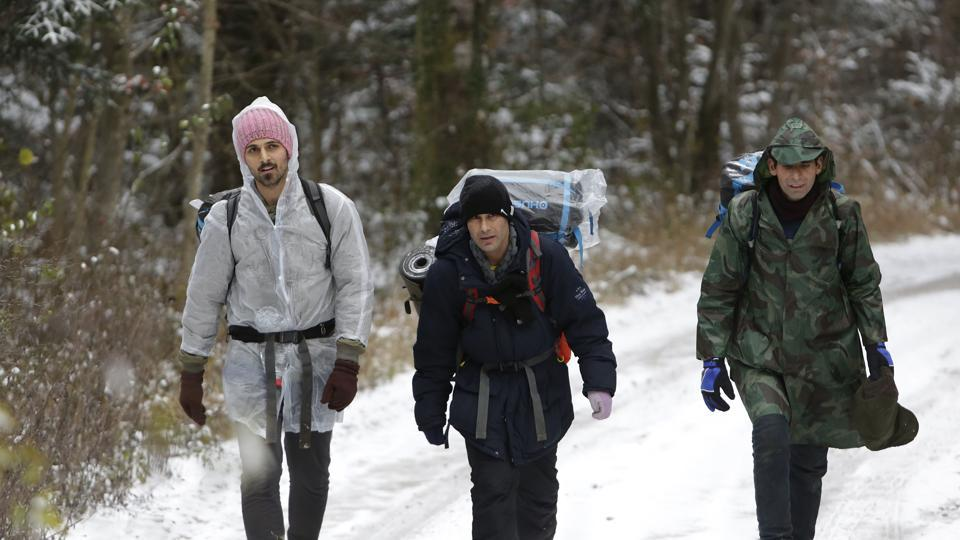 "A group of migrants moves through a forest on the Pljesevica Mountain in Bihac, Bosnia. Braving cold weather and snow, dozens are heading daily up a steep mountain pass toward neighbouring Croatia, trying to slip by unnoticed by border guards or police. Carrying sleeping bags and personal belongings, the migrants tread slowly through the snow in groups, with some waving: ""See you in Europe!"" (Amel Emric / AP)"