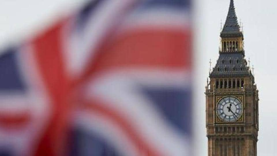 A Union flag flies in the wind in front of the Big Ben clock face and the Elizabeth Tower at the Houses of Parliament in central London on November 3.