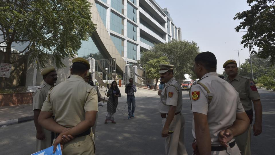 Police personnel keep vigil outside CBI headquarters in New Delhi.
