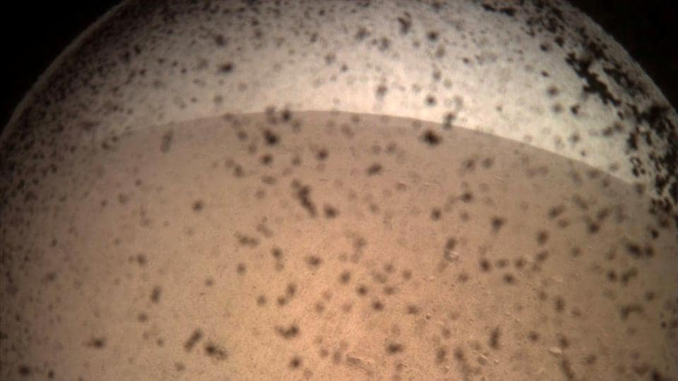 NASA's InSight Mars lander acquired this image of the area in front of the lander using its lander-mounted, Instrument Context Camera (ICC) with the ICC image field of view of 124 x 124 degrees, on Mars. (ASA / JPL-Caltech / Handout via REUTERS)