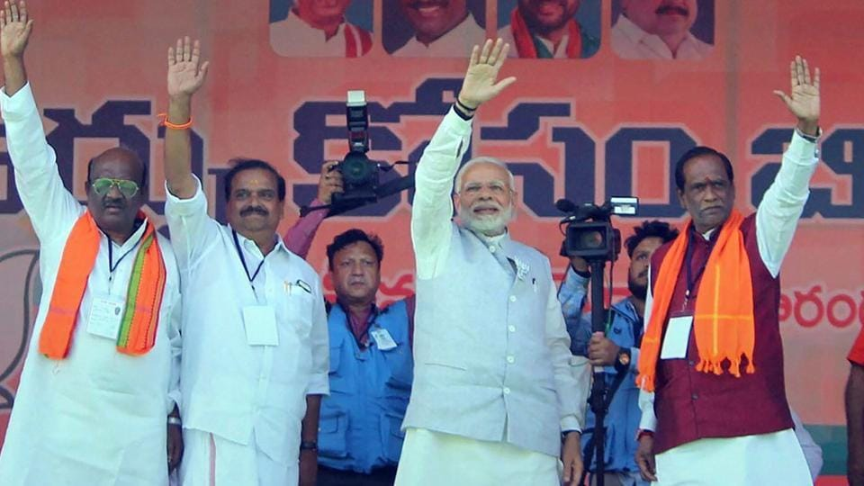 Prime Minister Narendra Modi waves at the crowd during an election rally in support of BJP candidates, in Mahbubnagar on November 27.