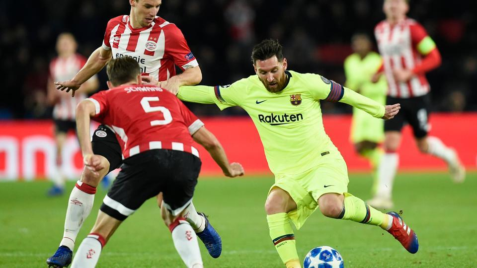 Eindhoven's defender Daniel Schwaab (left) vies with Barcelona's Lionel Messi (right) during their Champions League match.