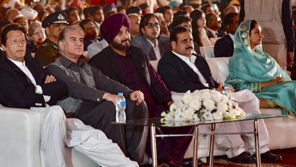 Pakistan's Prime Minister Imran Khan, foreign minister SM Qureshi, cricketer-turned-Indian politician Navjot Singh Sidhu, Minister for Food Processing Industries Harsimrat Kaur Badal and others during ground breaking ceremony for Kartarpur corridor in Pakistan's Kartarpur, Wednesday, Nov. 28, 2018.