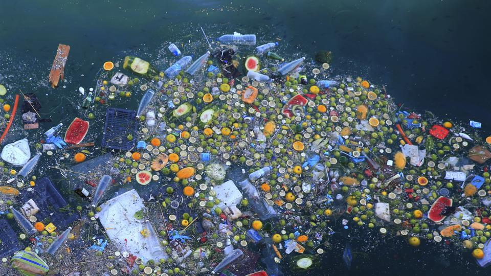 Trash floats next to rocky coastal area in the Mediterranean Sea on the Beirut coastline, Lebanon. Once a source of pride, the country's Mediterranean coastline has become a source of shame for many Lebanese because of the swirling trash that pollutes its shores. (Hassan Ammar / AP)