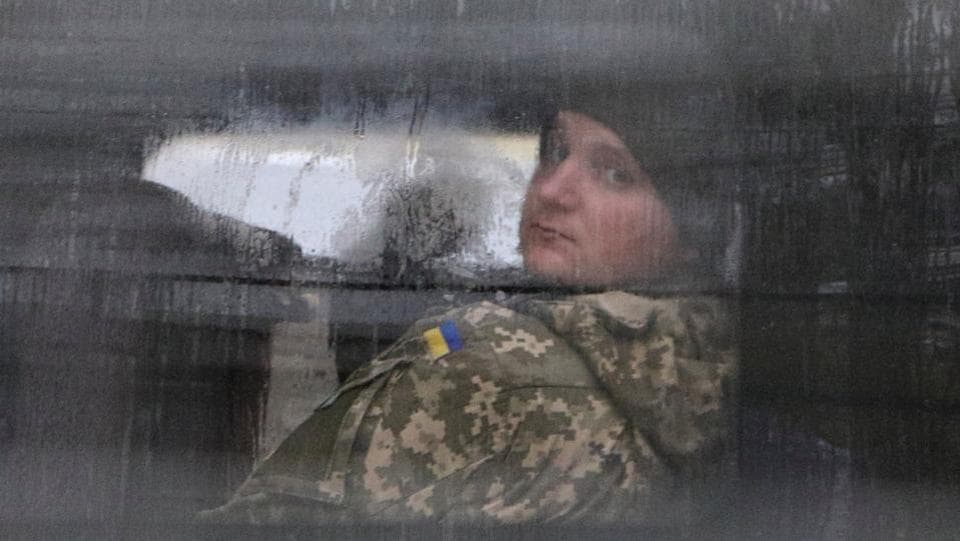 A detained Ukrainian serviceman and crew member of one of Ukrainian naval ships, which were recently seized by Russia's FSB security service, looks out of a minibus window outside a court building in Simferopol, Crimea. (Pavel Rebrov / REUTERS)