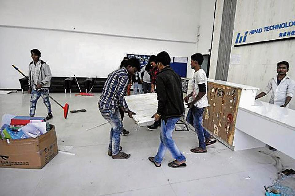 A view inside the Hipad Technology office after the workers of a mobile company pelted stones at the office building and clashed with the security during a protest for not receiving wages for more than three months, at Sector 63, in Noida, India, on Thursday, November 29, 2018. Phase 3 police is looking into the matter