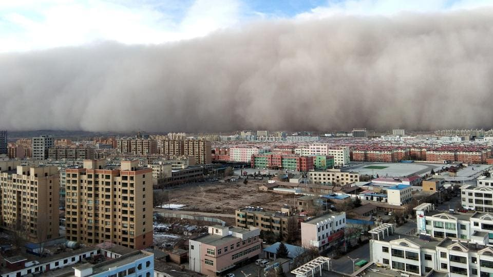 A a massive sandstorm that sparked rural fires, forced traffic to slow down and prompted residents to head for cove, hits the city of Zhangye in Gansu province, China. (Stringer / REUTERS)