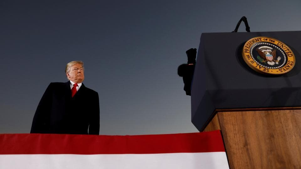 US President Donald Trump listens as Republican US Senator Cindy Hyde-Smith speaks at a Hyde-Smith campaign rally in Tupelo, Mississippi. (Kevin Lamarque / REUTERS)